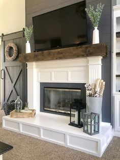 Is your fireplace dated and in need of a refresh? Check out this fireplace makeover. The before and afters are amazing! fireplace surround farmhouse Fireplace Makeover from Contemporary to Modern Farmhouse - Repurpose Life Build A Fireplace, Home Fireplace, Fireplace Remodel, Living Room With Fireplace, Fireplace Surrounds, Fireplace Design, Home Living Room, Fireplace Ideas, Simple Fireplace