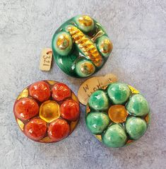 A group of  vintage ceramic Rose Laury buttons in bright colours. 2-2.5cms.