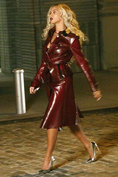 Beyonce working it like she always does in a Burberry Porsum blood red latex trench coat.