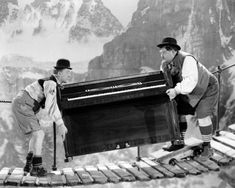 Comedians Oliver Hardy and Stan Laurel carry a piano across a rope bridge in a scene from 'Swiss Miss' directed by John G Blystone 1938 An escaped...