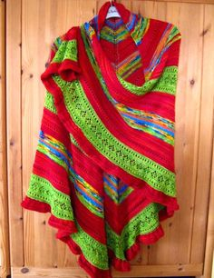 A big shawl is a great way to use up lots of leftover yarn. This one is in fingering weight yarn. Blog article discusses the design and free instructions are available.