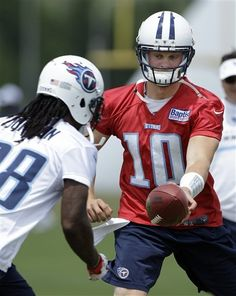 Tennessee Titans quarterback Jake Locker (10) hands off to running back Chris Johnson (28) during a workout at the team's NFL football training facility on Wednesday, June 6, 2012, in Nashville, Tenn. (AP Photo/Mark Humphrey)