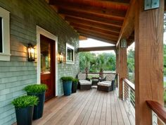 With Low Country style in mind, the front porch boasts sword grass, sage green siding and tropical garapa wood decking.