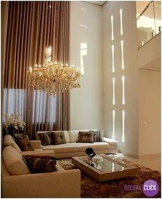 Hoje é dia de SALA DE ESTAR!  O sofá branco e as almofadas em tons mais escuros…