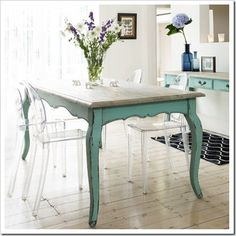 Love the color on this table's base. This this the color I want in my dining room