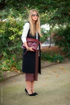 Oxblood clutch and printed pants