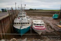 Low Tide at the Alma Docks, New Brunswick, Canada. These fishing boats have to wait a while to go out.