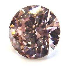 1.01ct. Round Fancy Pinkish Brown Diamond