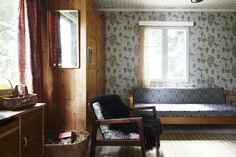 Cabin like feel living room, wallpapered, modern furniture,