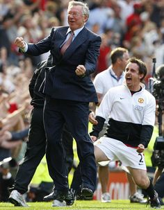 ... celebrating victory with Gary Neville