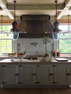 range flanked by windows...love Mark D. Sikes: Chic People, Glamorous Places, Stylish Things