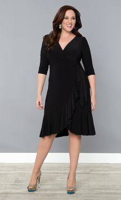 Every woman has a flirty side, play yours up with our plus size Whimsy Wrap Dress.  A classic functional wrap silhouette and beautiful cascading flounces exude playfulness and style. #KiyonnaPlusYou #Plussize #Kiyonna