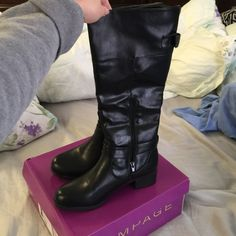 NIB rampage black boots size 6 NIB rampage black boots size 6.  Selling because it's too big for me.  Nice boots. Never been worn. Rampage Shoes