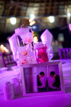 Framed engagement pictures as part of centerpieces