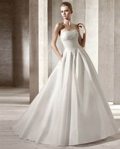 Gesinee's Bridal | Designer Gowns    Pronovias    Strapless satin gown with pleated bodice and box pleated ballgown skirt.
