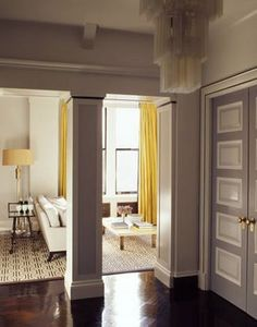 Grays and yellow. Openings frame the room. I love this door, I think I will attempt to do my doors this way!