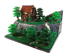 https://flic.kr/p/BoLZUY | At the Mountain Lodge | Yes, it has been a very long time since I have built something. This was started months ago, taking much longer then it should have. There is no real story accompanying this MOC, just a house on a mountain. Hope you enjoy!