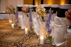 Floral and candle aisle markers Wedding Walkway, Aisle Markers, Wedding Planning, Runway, Candles, Table Decorations, Creative, Floral, Unique