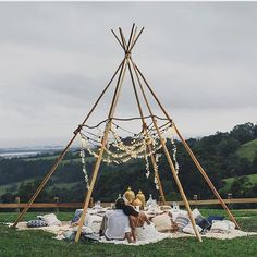 You may want to avert your eyes - this tepee is naked! Wouldn't this fairy light adorned, cosy set up make a gorgeous alternative to a sweetheart table at a laid back boho wedding? Or perhaps just a cool place for guests to hang out and admire the view.
