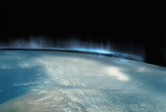Amazing blue Aurora Borealis as seen above Earths atmosphere, taken from outer space
