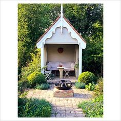 A gazebo of sorts with seat is an excellent idea to view the garden.