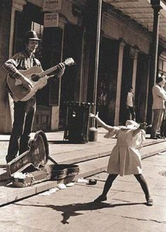A Street Musician And A Little Girl