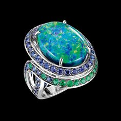Boucheron White gold ring, set with an oval opal, blue and purple sapphires and emeralds. Aiguebelle collection