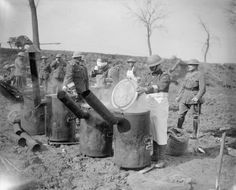 Battle of Arras, April 1917. R.A.M.C. men boiling cookers of tea for the wounded at Feuchy cross roads.