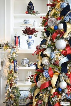 Red, white and blue Christmas decorating ideas! I'm sharing a sneak peek of this year's holiday look around our home! Head over + get inspired! #christmasdecorating #christmasideas #christmastree