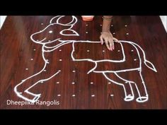 Sankranthi gangireddu Muggulu | Basavanna Muggulu | Mattu pongal kolam 2020 - YouTube Easy Rangoli Designs Diwali, Indian Rangoli Designs, Rangoli Designs Latest, Rangoli Designs Flower, Free Hand Rangoli Design, Rangoli Border Designs, Rangoli Ideas, Rangoli Designs With Dots, Rangoli Designs Images