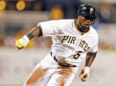 Pirates shortstop Josh Harrison races to score in the second inning.