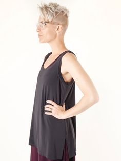 Tunic Tank A simple jersey tank with side vents is designed for easy layering. Made in Canada.