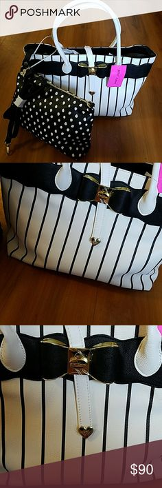 🛑FINAL DAY- LAST CHANCE🛑 BETSEY JOHNSON TOTE! 🛑FINAL SALE NWT-LAST CHANCE TO ORDER LAST ONE-  NWT- BETSEY JOHNSON 2 IN ONE TOTE! BEAUTIFUL BAG OFFERS SO MUCH YOU GET TWO HANDBAGS FOR ONE PRICE 1ST BAG PLENTY OF SPACE FOR ANYTHING WORK OR HOME 2ND BAG HAS A DETACHABLE STRAP AND CAN BE USED ALONE. JUST A GREAT PAIR & SUCH A BEAUTIFUL DESIGN  SIZE:1ST BAG 15X12 -  2ND BAG:13X8  🌹NWT-BRAND NEW WITH TAGS 🌹SAME DAY SHIPPING 🌹100% AUTHENTIC -PLEASE READ MY CLOSET RULES AND FOLLOW! Betsey…