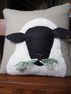 Primitive Wooly Sheep Decorative Pillow. $28  http://www.etsy.com/listing/90368207/primitive-wooly-sheep-decorative-pillow