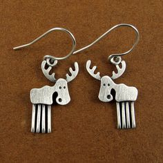These wild little moose are made of sterling silver with a brushed finish. The moose themselves are about 3/4 tall, which means they are TINY,