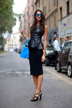 A leather peplum lends edge to the feminine trend.   - HarpersBAZAAR.com