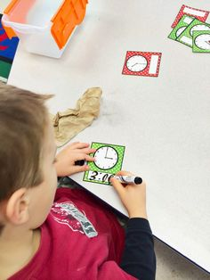 FREE Telling Time Math Centres: reading analogue clocks and writing digital times