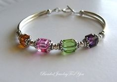 """Mother's birthstone bracelet by: """"beaded jewelry for you."""""""