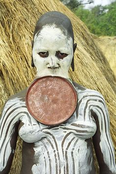 Mursi Woman, Ethiopia. I have to wonder, how does one even talk when they have to wear that disc in their mouth?
