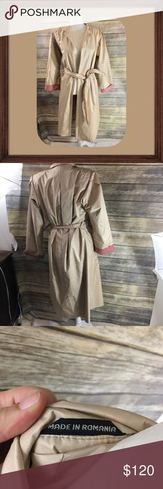 Made In Romania Career Chic Tan Long Jacket Made In Romania Career Chic Long tan jacket. In good used condition normal wear, size 8. Fully lined. Pockets on sides. Ties inside and outside. 46 inches long. 19 inches arm pit to arm pit. 24 inch sleeves. Made In Romania Jackets & Coats Trench Coats