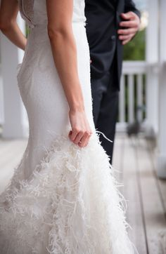 Glam feather accented wedding dress: http://www.stylemepretty.com/2016/03/17/trending-feather-wedding-details-that-soar-new-stylish-heights/