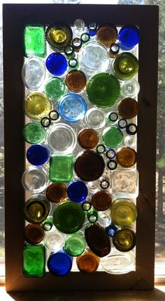 "UPCYCLE: Very cool upcycled glass window. ""A collection of multi-colored and shaped bottles have been repurposed into an awesome window panel. Brilliant when backlit by the sun (or you could add LED rope lighting.) I spent hours collecting, cutting and cleaning the bottles and use the top and bottoms of the bottles."" (by lowlightcreations, etsy)"