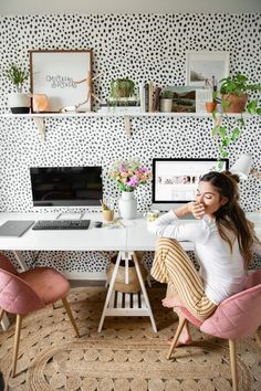 What great home office ideas! Polka dot wallpaper is the best backdrop to this home office design, and the pink velvet desk chairs are also the perfect home office decor! The combination of the two make for a glam home office dream.