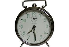 Working Mid-Century Modern alarm clock by Kienzle with chrome finish and glow-in-the-dark numbers.