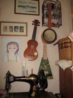I hung my instruments on the wall in my computer room; my paints and one of my sewing machines lives there, too.