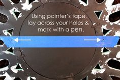 Use painters tape to mark the holes of the items that require two nails to hang, then place the tape on the wall and drill your holes.