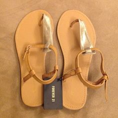 FOREVER 21 Suede Gold Metallic Sandals Size 8 US Brand new with tags still attached! FOREVER 21 suede metallic gold and tan sandals. Super cute with jeans, leggings, skirts or dresses Forever 21 Shoes Sandals