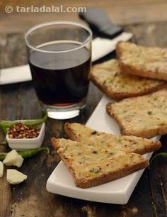 The use of two varieties of cheese in just the right proportions and a sprinkling of mustard powder along with the chilli flakes makes this version of Chilli Cheese Toast very special. Adding a little milk to the cheese ensures it coats the bread well and doesn't dry up while baking. However, make sure you serve this baked Chilli Cheese Toast as soon as you prepare it, to relish its fresh flavour, strong aroma of toasted spices and ideal texture.
