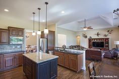 The open spaces of this #kitchen and great room allows easy communication. The Foxglove #1297. http://www.dongardner.com/house-plan/1297/the-foxglove. #OpenConcept #HomePlan