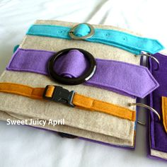 Buckle page. Two to three felt belts sewn across page, each with a different buckle in the middle so your child can practice buckling. The type and size of buckles on your page will vary depending on what is available in my supply. You can message me to let me know which buckles you like best and/or if you have a special request for a certain kind, and I will let you know if I can accommodate it.  Can be made in any color scheme. If no colors are specified I will make it how I think looks…